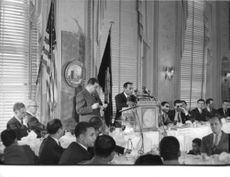 King Hassan II of Morocco giving his speech in front of the crowd.
