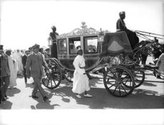 King Hassan II of Morocco riding the horse carriage.