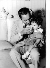 King Hassan II of Morocco holding his daughter.