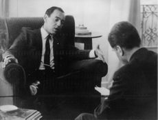King Hassan II talking to unknown man.
