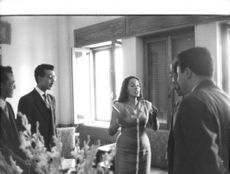 Princess Lalla Aicha of Morocco speaking with men.