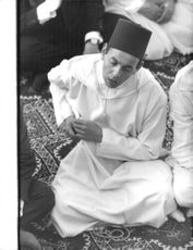 Mohammed V Sultan of Morocco in a ceremonial prayer.