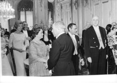 Former French prime minister Antoine Pinay standing front of 18th President of France Charles de Gaulle, Hassan II of Morocco and Yvonne de Gaulle