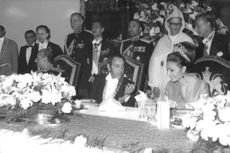 King Hassan II with his wife in an event.