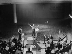 Charlie Chaplin conducting orchestra.