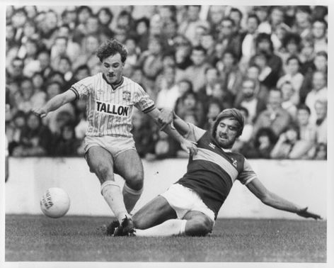 Billy Bonds and Terry Gibson are fighting for the ball