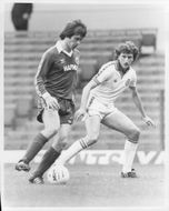 Peter Eastoe and Paul Hart are fighting for the ball