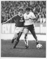 Steve Wigley and Gary Mabbutt fight for the ball