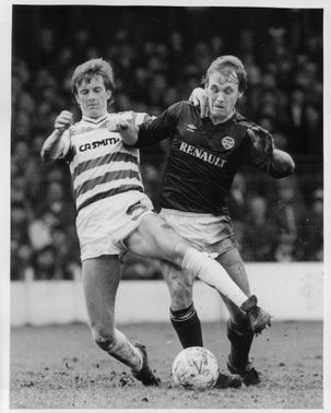 Pierce O'leary and Sandy Clark are fighting for the ball
