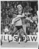Brian Stein and Mark Wright are fighting for the ball