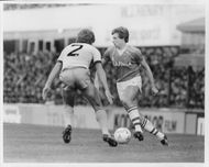 Kevin Sheedy and Ray Stewart are fighting for the ball