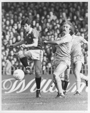 Gary Birtles and Gerry Gow are fighting for the ball