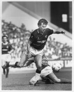 Brian Whittaker and Ally McCoist fight for the ball