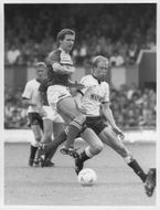 Trevor Senior and Mark Wright are fighting for the ball