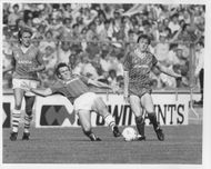 Kevin Richardson, Peter Reid and Steve Nicol are fighting for the ball