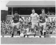 Paul McGrath, Bryan Robson and John Wark are fighting for the ball