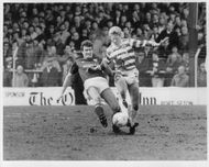 Sandy Jardine and Maurice Johnson are fighting for the ball