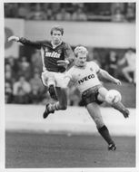 Gordon Cowans and Les Taylor are fighting for the ball
