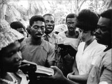 A nurse reading the bible with the locals in The Albert Schweitzer Hospital in Lambaréné, Gabon.