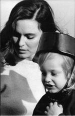Italian actress and former wife of Luis Miguel Dominguín, Lucia Bosè, with her child.
