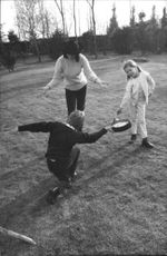 Italian actress and wife of Luis Miguel Dominguín, playing with her two children.