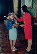 First Lady Flower Diploma. Queen Silvia delivers diploma to Emma Gillgren in Stockholm Castle