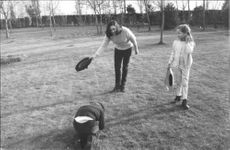 Wife of Luis Miguel Dominguín, Lucia Bosè, bowing down to her son while playing bullfighting with her two kids.