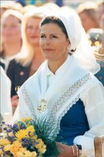 Portrait picture of Queen Silvia with the classic headdress of the national costume. The picture is taken in conjunction with the Crown Princess Victorias birthday.