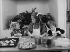 Princess Madeleine, Crown Princess Victoria and Prince Carl Philip Bake Lice cats in the kitchen at Drottningholm