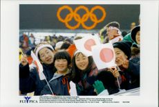 Japanese children wave with the Japanese flag during the opening ceremony of the Winter Olympics in 1998