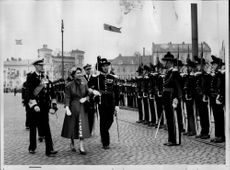 Queen Elizabeth II and King Haakon inspect the royal guard during the Queen's visit to Norway.