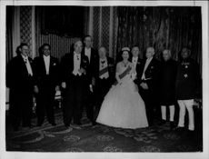 Queen Elizabeth II together with international delegates during a royal dinner at Buckingham Palace.