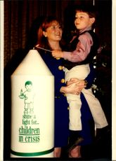 Sarah Ferguson is in a small boy at the opening of the Children in Crisis charity event.