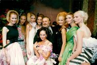 Gianfranco Ferre along with models after a view for Dior