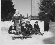 Children skiing on the snow during the Winter war, 1942.