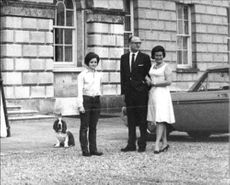 13th Duke of Bedford Ian Russell with his third wife Nicole Russell and a lady looking at something with smiling face