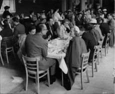John Ian Robert Russell, 13th Duke of Bedford, dining with the 51 American tourists.