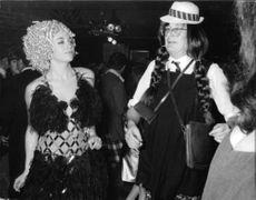 Marie-Christine Barclay with John Ian Robert Russell, 13th Duke of Bedford, at a costume party.
