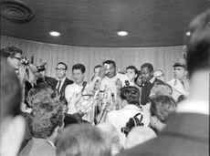 Floyd Patterson surrounded by media.