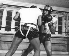 Floyd Patterson fighting.
