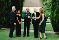 President Nelson Mandela and Josine Machel welcome Andre Agassi and Brooke Shields at a dinner in connection with Nelson Mandela Tribute