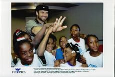 American tennis player Andre Agassi with a bunch of children at Andre Agassi Boys and Girls Club