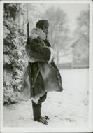A Finnish Army standing on the snowy ground while on guard.