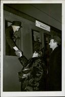 A young boy bidding his parents goodbye in the train station during the mass evacuation. 1939