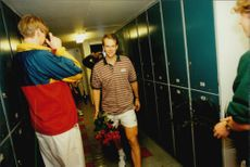 Tennis player Stefan Edberg is photographed in the dressing room with flower bouquet in hand after his last match in Stockholm Open 1996