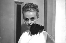 Jeanne Moreau looking at camera.