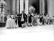Jeanne Moreau, as Catherine the Great, leading dance.