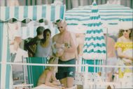 Paparazzi fire at Boris Becker and his wife Barbara on the beach in Monaco.
