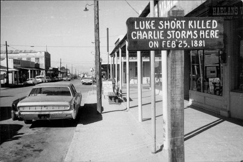 """Marked with the words """"Luke Short killed Charlie Storms here on Feb 25, 1881"""" on a street in Tombstone"""