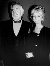 "Kenny Rogers with spouse at the ""Emmy Awards"" 1990"